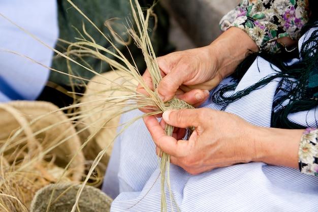 Esparto woman hands handcrafts mediterranean