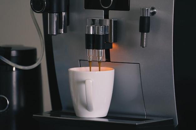 Espresso automatic coffee machine with cup