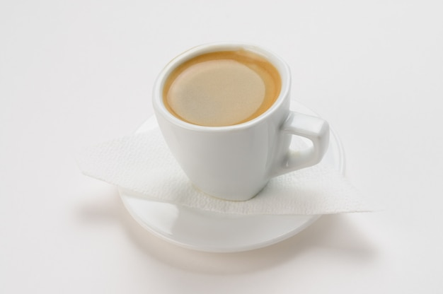 Espresso coffee in a cup on a white surface