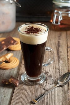 Espresso coffee. espresso drink with cream, topped with whipped cream. rustic wooden .