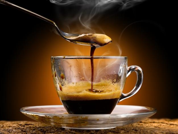 Espresso coffee poured into a glass cup