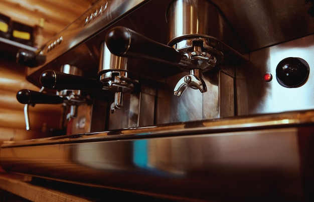 Espresso machine in pub, bar, restaurant. professional coffee machine. closeup