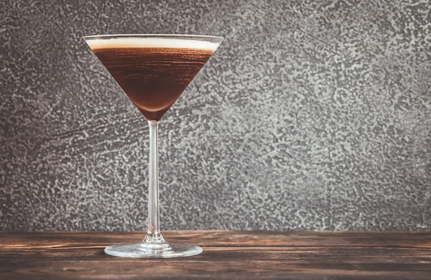 Espresso martini cocktail garnished with coffee beans