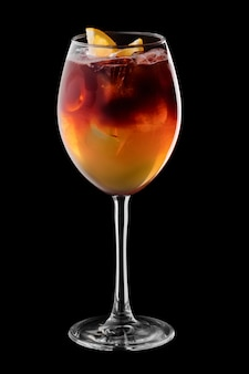 Espresso and tonic cocktail in wine glass isolated