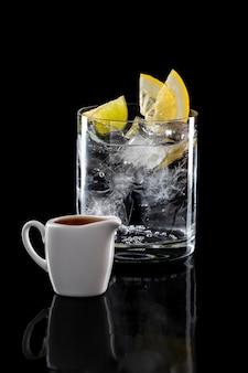 Espresso tonic refreshing drink isolated on black background