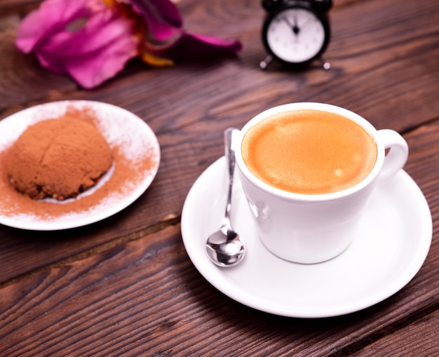 Espresso in a white cup with saucer