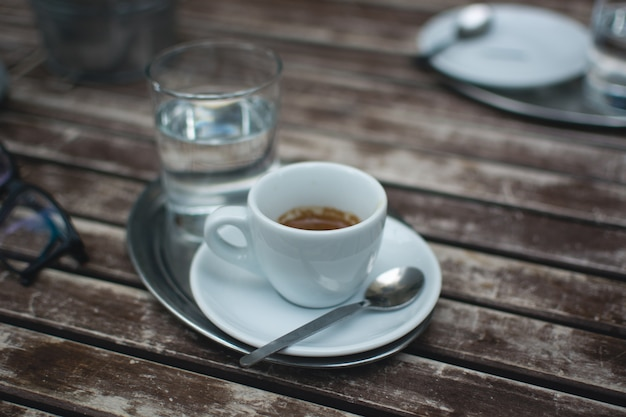 Espresso on a wooden table outside