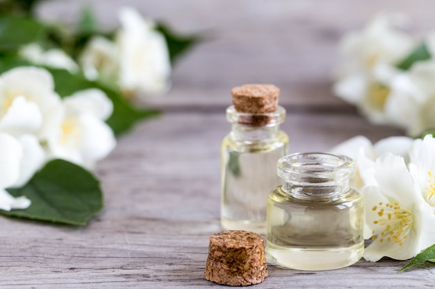Essential jasmine oil. massage oil with jasmine flowers