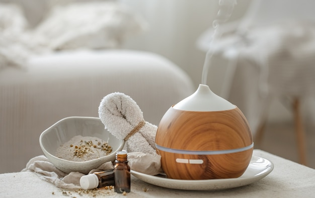 Essential oil aroma diffuser humidifier diffusing water articles in the air.