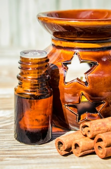Essential oil of cinnamon and star anise in a small bottle.
