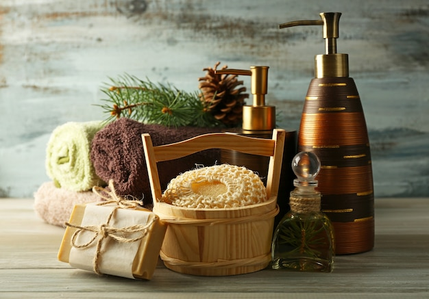 Essential oil of pine, handmade soap and cream with pine extract and spa treatments on wooden