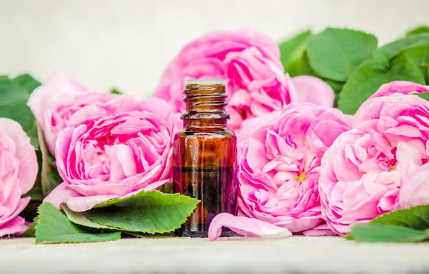Essential oil of rose on a light background. selective focus.