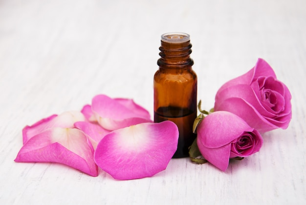 Essential oil and rose petals