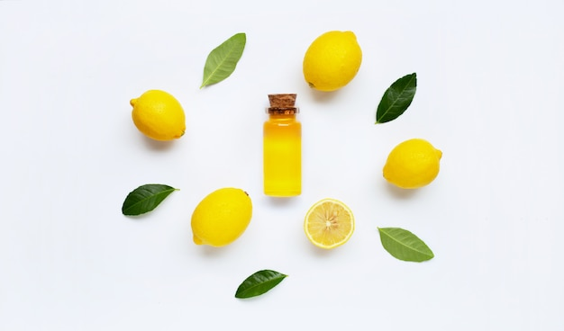 Essential oil with lemon on white.