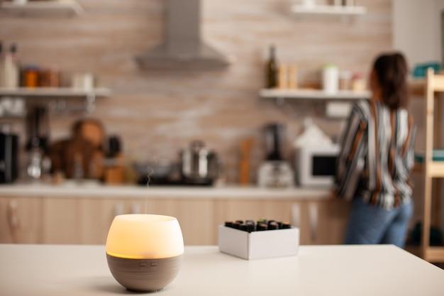 Essential oils diffuser distributing aromatherapy
