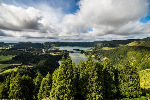 Establishing shot of the lagoa das sete cidades lake taken from vista do rei in the island of sao miguel, the azores, portugal. the azores are a hidden gem holiday destination in europe.