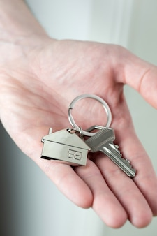 Estate agent giving house keys to client for new home