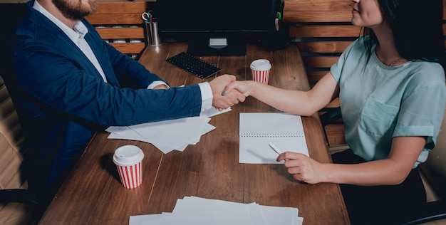 Estate agent with customer after contract signature. handshake. real estate concept.