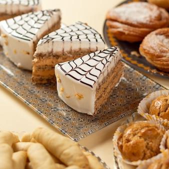 Esterhazy dessert, hungarian cake, white yogurt cake on the table
