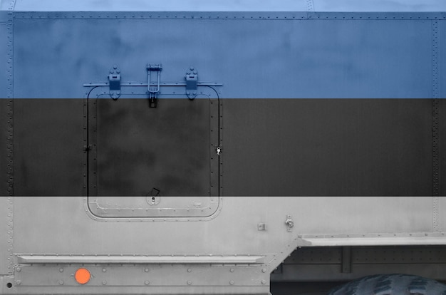 Estonia flag depicted on side part of military armored truck closeup. army forces conceptual background