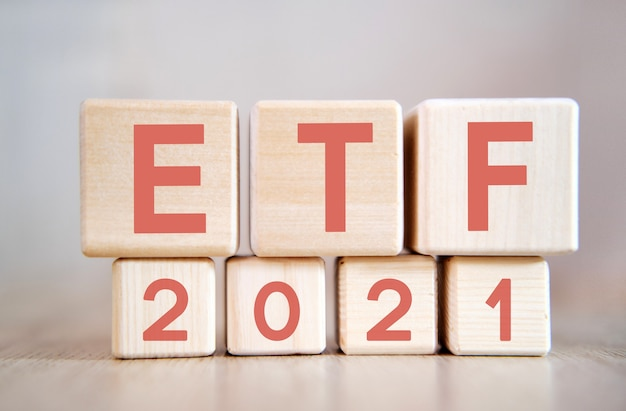 Etf 2021 on wooden cubes, on wooden background.