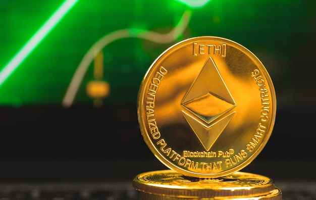 Ethereum coin on background of green stock chart, close-up view photo