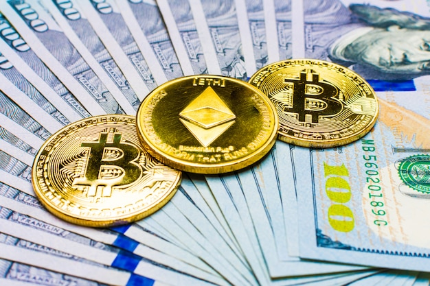 Ethereum coin and banknotes one hundred on dollars