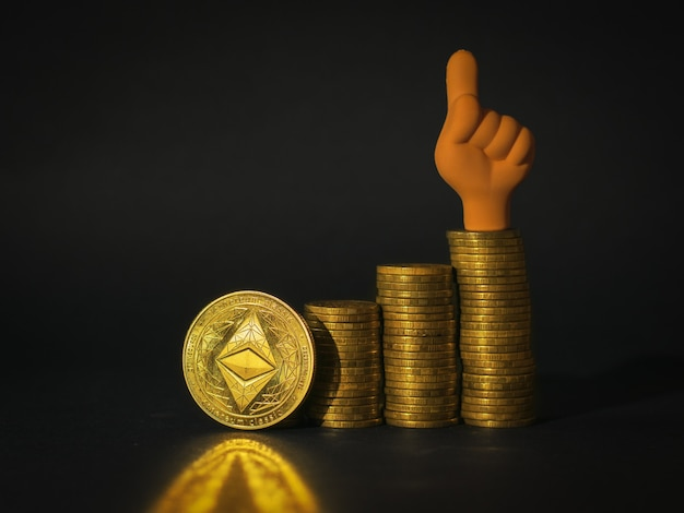 An ethereum coin, stacks of coins and a figure of a hand with a finger up on a black background. the concept of the rise in the price of cryptocurrency.
