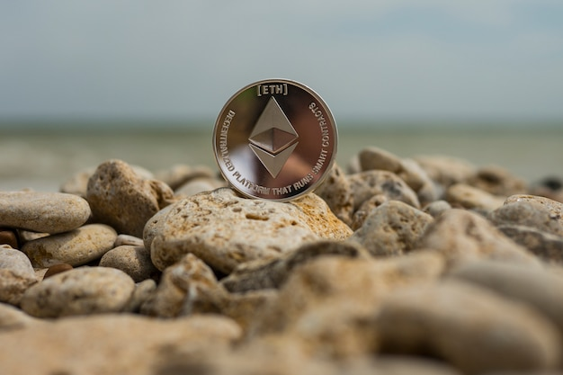 Ethereum cryptocurrency. e-currency. summer beach. sea stones