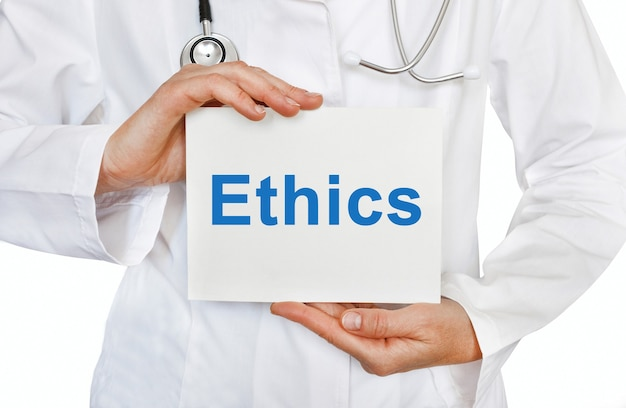 Ethics card in hands of medical doctor