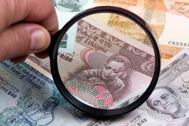 Ethiopian birr in a magnifying glass a business background