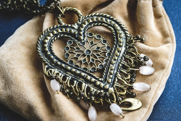 Ethnic boho style heart pendant with white beads