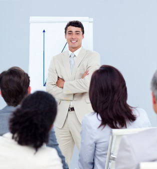 Ethnic businessman reporting sales figures