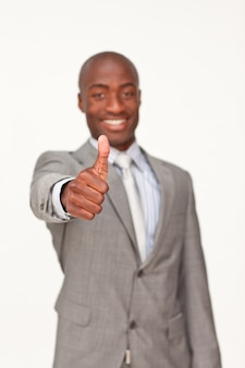 Ethnic businessman with thumbs up
