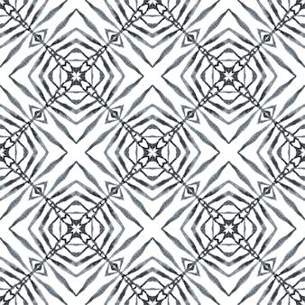 エスニック手描きパターン。黒と白の意外な自由奔放に生きるシックな夏のデザイン。テキスタイル対応の素敵なプリント、水着生地、壁紙、ラッピング。水彩の夏のエスニックボーダーパターン。