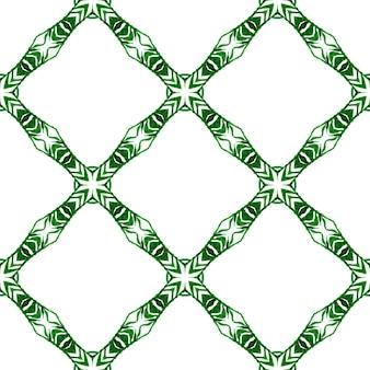 エスニック手描きパターン。緑の不思議な自由奔放に生きるシックな夏のデザイン。テキスタイル対応の比類のないプリント、水着生地、壁紙、ラッピング。水彩の夏のエスニックボーダーパターン。