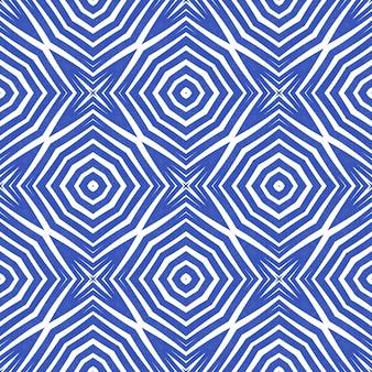 エスニック手描きパターン。インディゴ対称万華鏡の背景。サマードレスエスニック手描きタイル。テキスタイルレディシンメトリープリント、水着生地、壁紙、ラッピング。