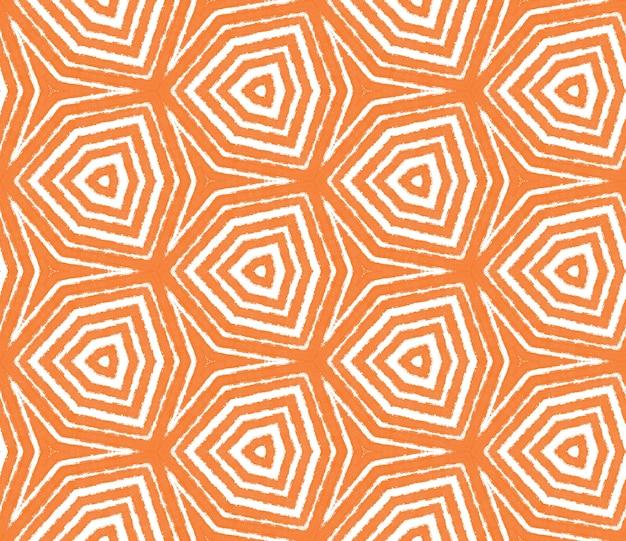Этническая ручная роспись картины. оранжевый симметричный фон калейдоскопа. готовый текстильный принт, ткань для купальников, обои, упаковка. летнее платье в этническом стиле, расписанное вручную плиткой.