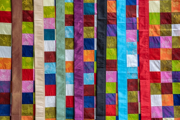Ethnic hmong patchwork quilt to sell for tourists on the street in mountain village sapa, north vietnam
