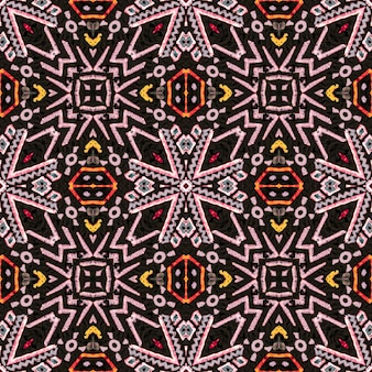エスニックパターン明るい。装飾芸術。レッドグリーンブラウンジグザグシームレスパターン