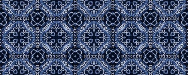 Этнический бесшовный образец на джинсовой ткани индиго