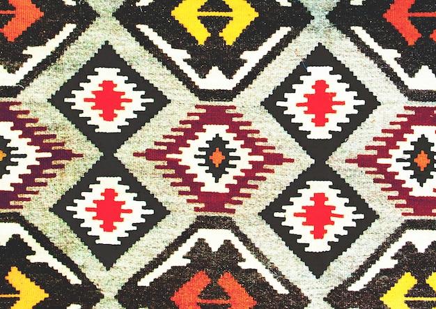 Этнический дизайн текстуры. традиционный дизайн ковров. ковровые украшения.