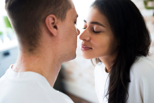 Ethnic woman going to kiss boyfriend