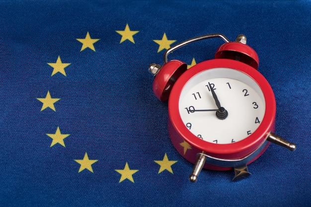 Eu flag and vintage alarm clock. close up. time to join the eu concept