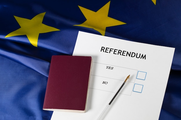 Eu referendum ballot paper black pen and passport on the table closeup