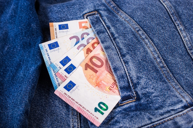Euro banknote in jeans