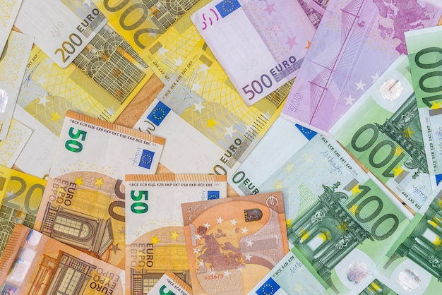Euro banknotes as background on wooden desk