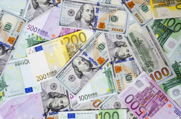 Euro banknotes and dollars randomly laid out