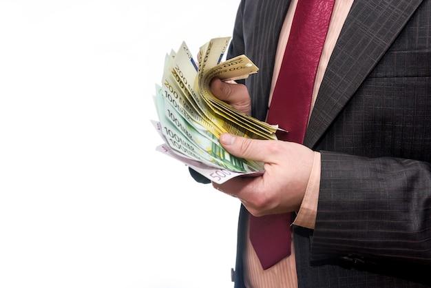 Банкноты евро в веер в мужской руке