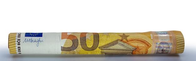 Euro banknotes rolled into a tube european union money closeup